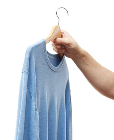 men hand holding hanger with sweater photo