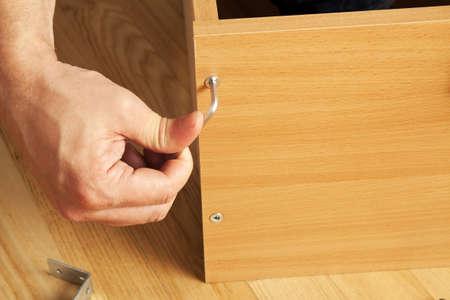 mounting: Carpenter mounting wooden furniture