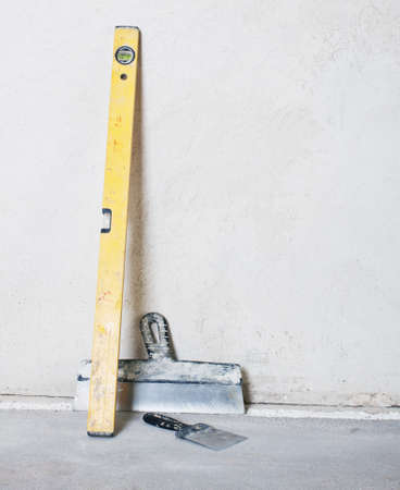 old dirty level with trowel photo