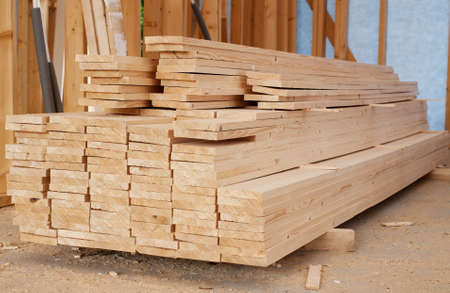 Stack of wooden planks inside house photo