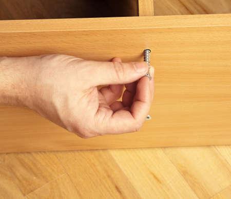 rearrange: Carpenter mounting wooden furniture