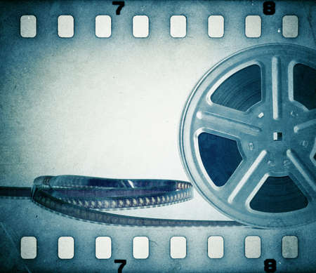 Old motion picture film reel with film strip. Vintage background photo