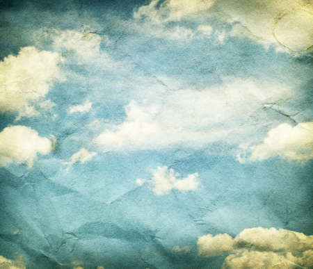 crumpled paper: Vintage clouds and sky on crumpled paper texture. Stock Photo