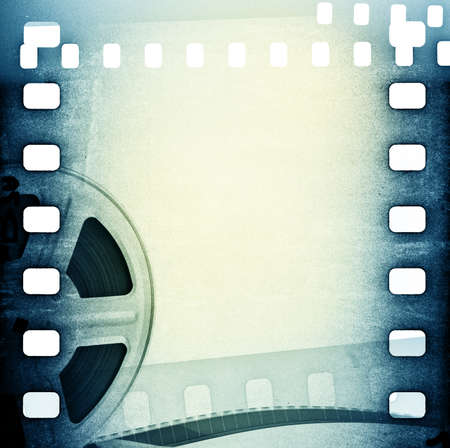 celluloid film: Old motion picture film reel with film strip.