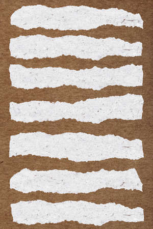piece of paper: collection of white torn paper on brown background Stock Photo