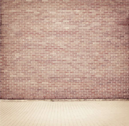 Brick grunge weathered brown wall background with walkway
