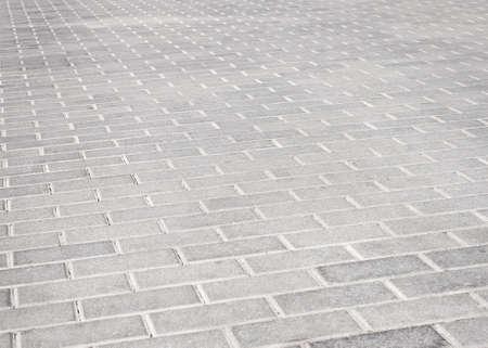 Ladrillo de piedra camino de la calle. La textura del pavimento Luz Foto de archivo