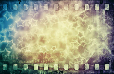 Grunge scratched colorful film strip background with stars photo