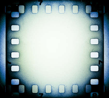 negative film: Grunge scratched film strip background with copy space