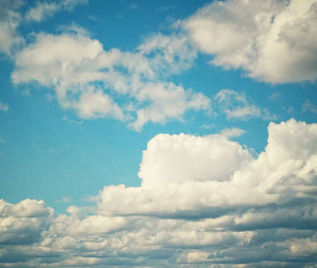 blu: Clouds in blue sky. Sunny time of day.