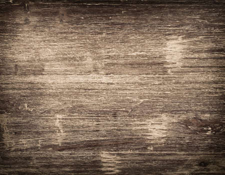 Dark scratched grunge cutting board. 免版税图像