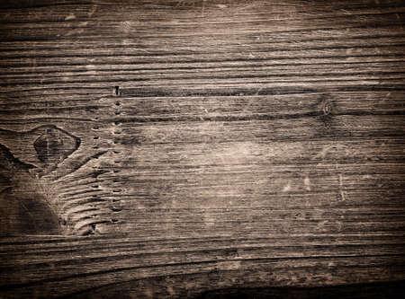 scratched: Dark scratched grunge cutting board. Stock Photo