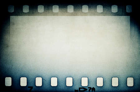 blue film: Grunge blue film strip background with copy space