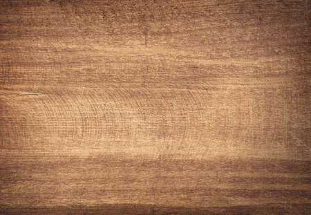 Brown scratched wooden cutting board. Wood texture. Stock Photo