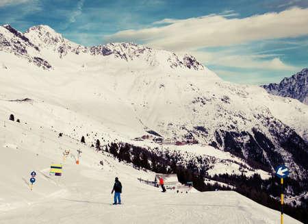 downhill: Young Alpine skier skiing downhill Stock Photo
