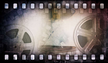 movie reel: Motion picture film reel with photostrip Stock Photo