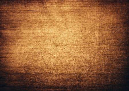Brown, orange scratched wooden cutting board.