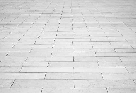 Gris calle camino de ladrillos de piedra. Acera de luz, la textura del pavimento