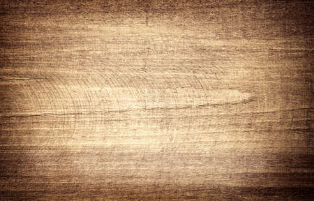 Brown scratched wooden cutting board. 免版税图像