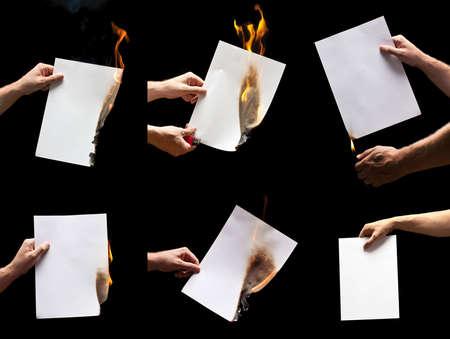 encendedores: La mano del hombre que sostiene los papeles quema más ligeros y blanco con espacio para texto