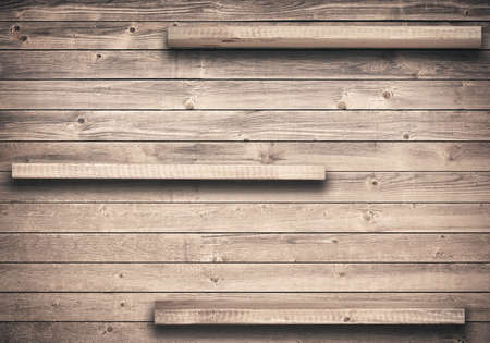blank wall: Old brown empty shelf on wooden wall Stock Photo