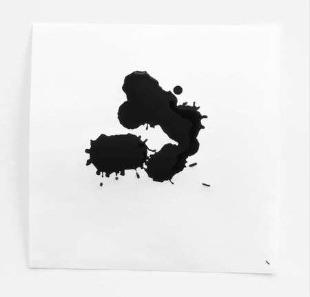 note paper: Black ink watercolor splahs, blots on white note paper