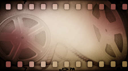 Films: Grunge old motion picture reel with film strip. Vintage background Stock Photo
