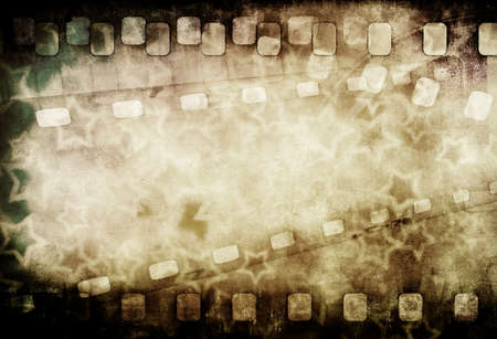motion picture: Grunge old motion picture reel with film strip and stars. Vintage background