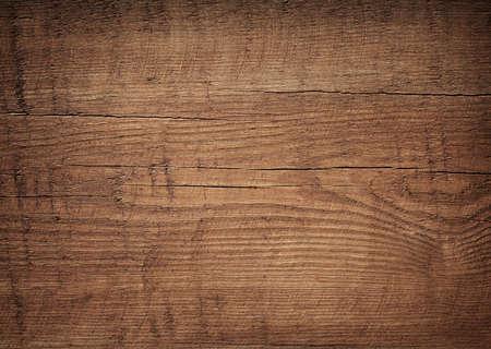 Tmavě hnědé poškrábaný dřevěném prkénku. Dřevo textury Reklamní fotografie