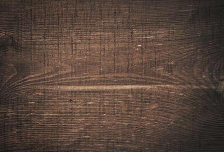 Donkerbruin bekraste houten snijplank. Houtstructuur Stockfoto