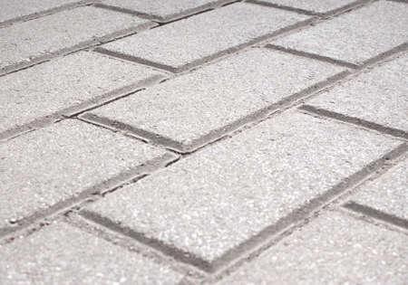 pave: Gray brick stone street road. Light sidewalk, pavement or wall texture Stock Photo