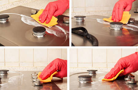 Man heand with red glove cleaning dirty gas stove