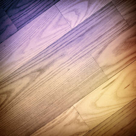 Colorful parqueted floor, wooden texture with diagonal planks photo
