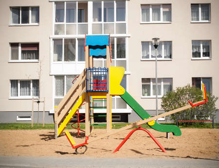 block of flats: Colorful children playground in nature, front of row newly built block flats