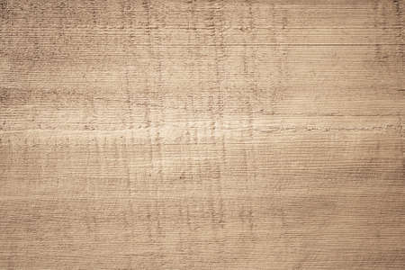 Brown scratched wooden cutting board. Wood texture. Standard-Bild