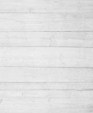 白い壁のフェンスの床またはテーブルの表面。木製のテクスチャです。