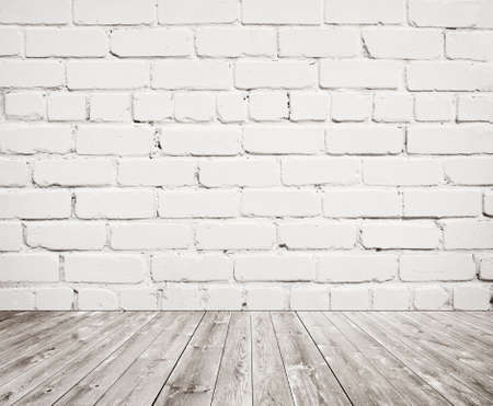 White brick wall texture with wooden floor.