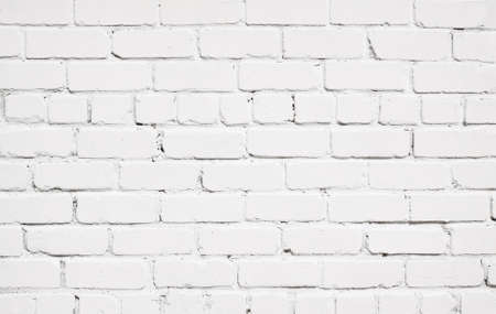 broken wall: White brick wall texture with wooden floor.