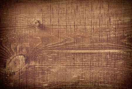 cutting board: Dark brown scratched wooden cutting board. Wood texture.