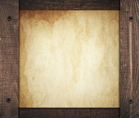 Composition of vintage dirty paper with old wooden wall planks. Stock Photo