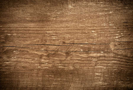 Dark brown scratched wooden cutting board. Wood texture.