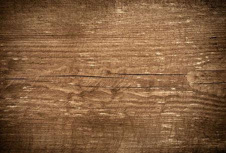 grunge texture: Dark brown scratched wooden cutting board. Wood texture.