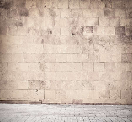 cinder: Weathered cinder block, brick wall texture with walkway.