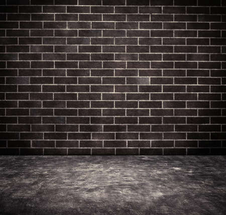 brick texture: Black grunge weathered brick wall texture with walkway. Stock Photo