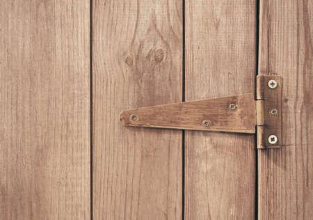 hinge: Close up of screwed hinge on door.