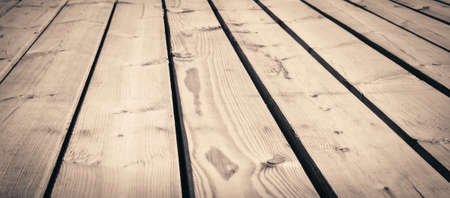 wooden surface: Light brown wooden texture planks, table, desk or wall surface.