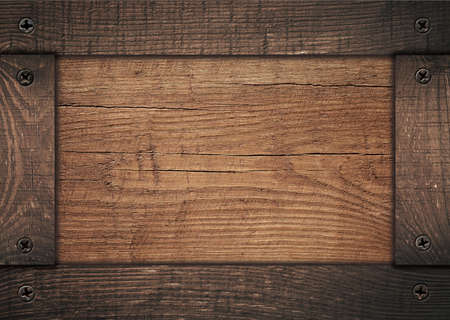 timber frame: Brown wooden frame screwed on wood board. Stock Photo