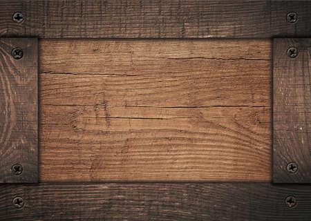 Brown wooden frame screwed on wood board. Foto de archivo