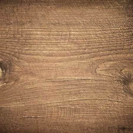 wooden board: Dark brown scratched wooden cutting board. Wood texture.