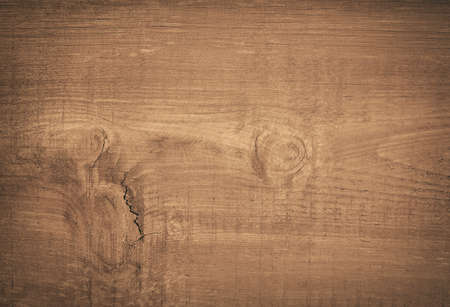 wood: Dark brown scratched wooden cutting board. Wood texture.